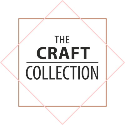 The Craft Collection Logo. A clear background featuring the words The Craft Collection stacked one on top of the other sitting inside a gold coloured square and a salom pink coloured diamond. The logo of Irish craft shape supplier The Craft Collection