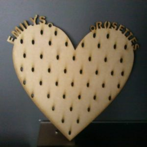 "Laser Cut wooden heart rosette holder. Reads ""Emily's Rosettes"" along the top curves of the heart. Brought to you buy Irish craft shape supplier The Craft Collection"