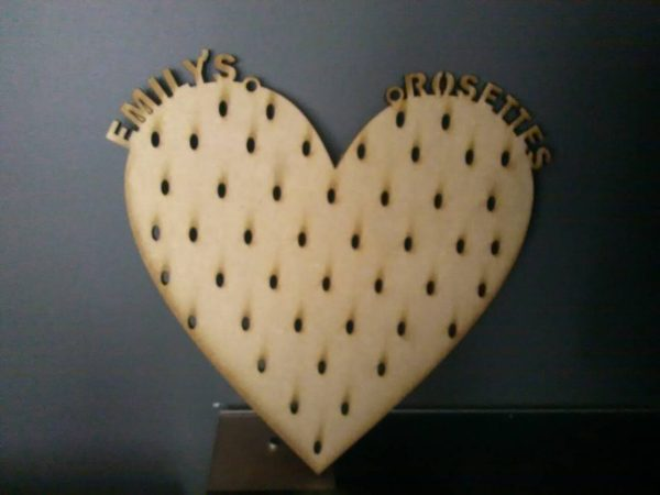 """Laser Cut wooden heart rosette holder. Reads """"Emily's Rosettes"""" along the top curves of the heart. Brought to you buy Irish craft shape supplier The Craft Collection"""
