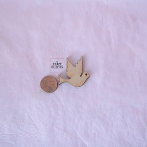 Dove Craft Shape Packets, Laser cut wooden dove craft shape beside a 1cent coin to show scale and against a pink background by craft shapes suppliers Ireland The Craft Collection