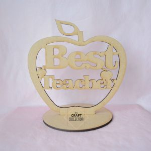 "Teacher Craft Shapes,Best Teacher Standing Apple craft shapes End of Term Teacher Gifts, laser cut wooden mdf apple shape with the words ""Best Teacher"" cut out decorated with small apple shapes. Against a pink background, by laser craft shapes supplier Ireland , The Craft Collection"