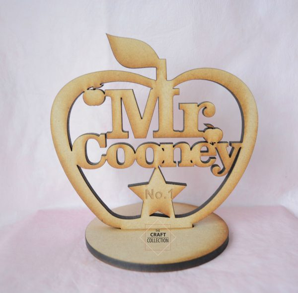 """Teacher Craft Shapes,Personalised Standing Apple craft shapes End of Term Teacher Gifts, laser cut wooden mdf apple shape with the words """"Best Teacher"""" cut out decorated with small apple shapes. Against a pink background, by laser craft shapes supplier Ireland , The Craft Collection"""
