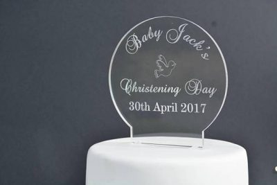 "Christening Day Cake Topper - Clear Acrylic Cake topper in the shape of a circle against a black background and on a white plain cake. Engraved with ""Baby Jacks Christening Day 30th April 2017"" laser engraved, laser cut cake toppers Ireland"