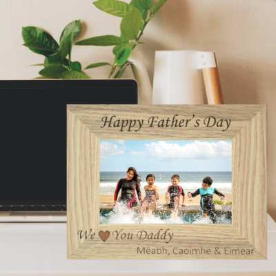 "We Love You Daddy Photo Frame is a personalised laser engraved photo frame that reads ""Happy Father's Day We Love You Daddy"""