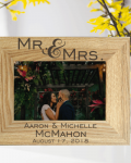 """Wedding Couple Photo Frame shows a light brown wooden photo frame standing in front of yellow flowers. It shoes a photo of a man and woman couple in a loving embrace and reads """"Mr & Mrs Aaron & Michelle McMahon August 17, 2018"""" laser engraved personalised wedding gifts by The Craft Collection Ireland"""