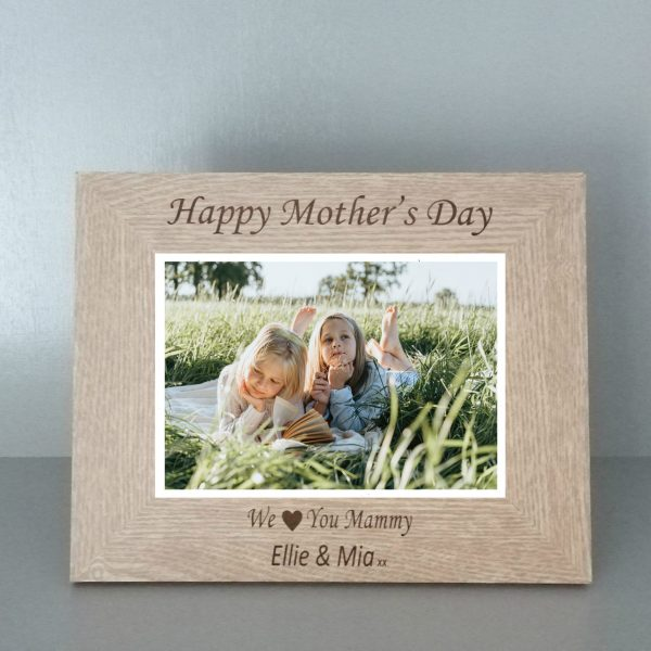 """Personalised Mother's Day Photo Frame. Brown photo frame with a picture of two girls inlaid, it reads """"Happy Mother's Day, We (heart) you Mammy. Ella & Mia xxx personalised gifts Ireland by The Craft Collection"""
